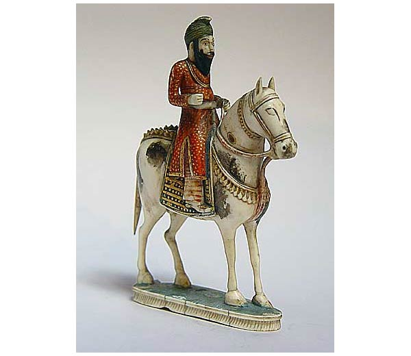 Punjab, An Akali Warrior Seated on a Horse, Early 19th Century, Polychrome ivory, 13 cms